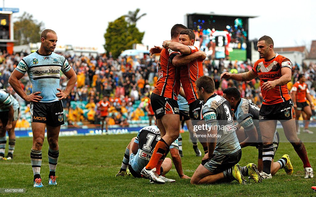 Tigers celebrate the try of Curtis Sironen during the round 26 NRL match between the Wests Tigers and the Cronulla Sharks at Leichhardt Oval on September 6, 2014 in Sydney, Australia.