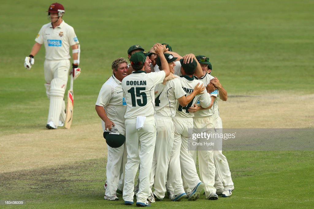 Tigers celebrate winning on day four of the Sheffield Shield match between the Queensland Bulls and the Tasmanian Tigers at The Gabba on March 10, 2013 in Brisbane, Australia.