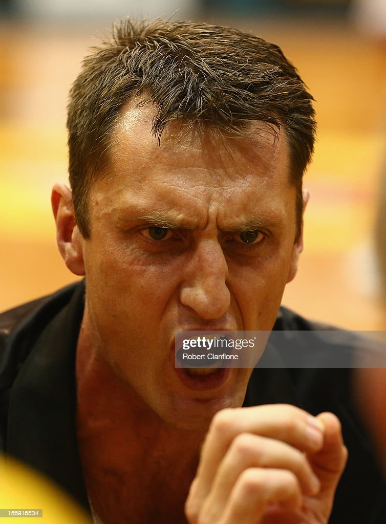 Tigers coach Chris Anstey talks to his players at the break during the round eight NBL match between the Melbourne Tigers and the Wollongong Hawks at State Netball Hockey Centre on November 25, 2012 in Melbourne, Australia.