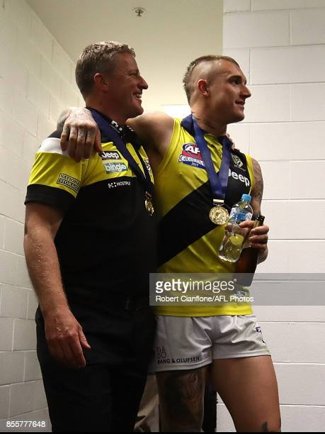 Tigers coach Damien Hardwick and Dustin Martin arrive for a press conference after the Tigers defeated the Crows at the 2017 AFL Grand Final match...