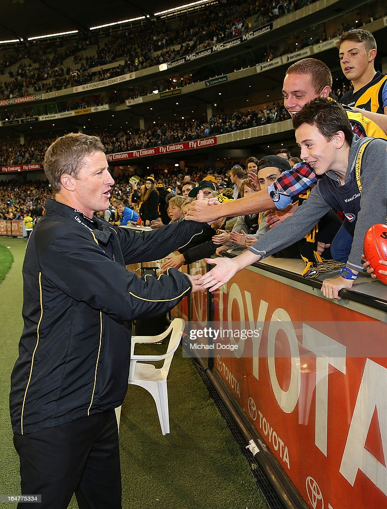 Tigers coach Damien Hardwick celebrates with supporters after their win during the round one AFL match between the Carlton Blues and the Richmond Tigers at Melbourne Cricket Ground on March 28, 2013 in Melbourne, Australia.