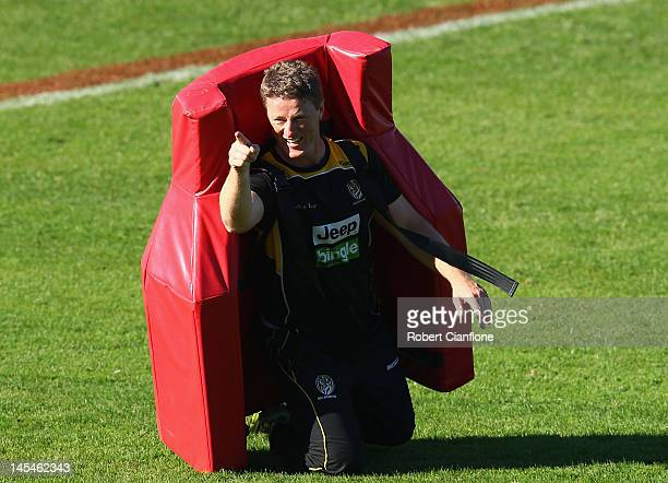 Tigers coach Damien Hardwick gestures during a Richmond Tigers Training Session at ME Bank Centre on May 31 2012 in Melbourne Australia