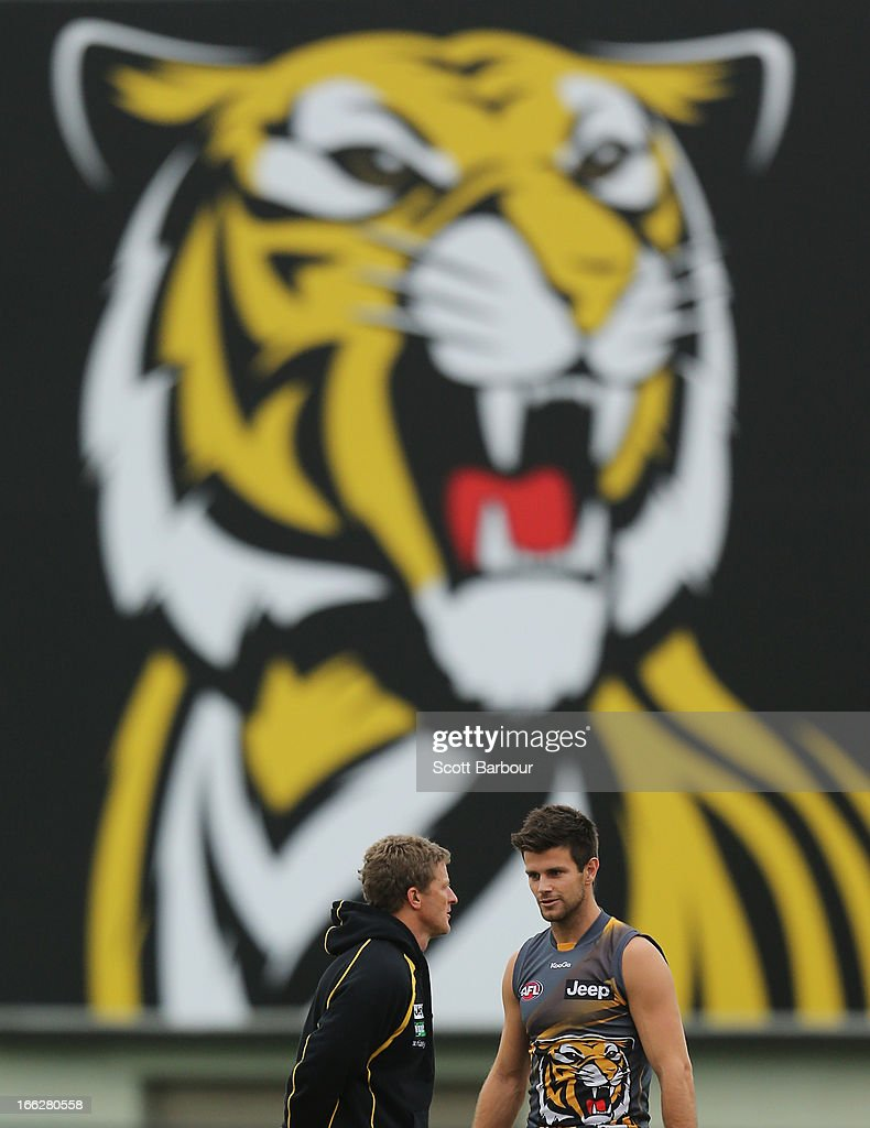 Tigers coach <a gi-track='captionPersonalityLinkClicked' href=/galleries/search?phrase=Damien+Hardwick&family=editorial&specificpeople=162730 ng-click='$event.stopPropagation()'>Damien Hardwick</a> (L) talks with Trent Cotchin during a Richmond Tigers AFL Training session at ME Bank Centre on April 11, 2013 in Melbourne, Australia.