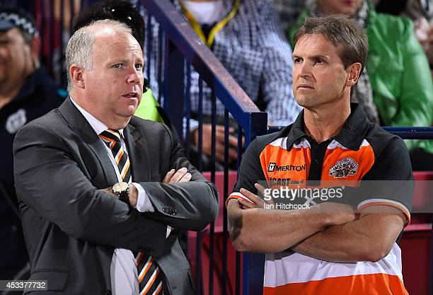 Tigers coach Mick Potter talks with Tigers CEO Grant Mayer before the start of the round 22 NRL match between the North Queensland Cowboys and the...