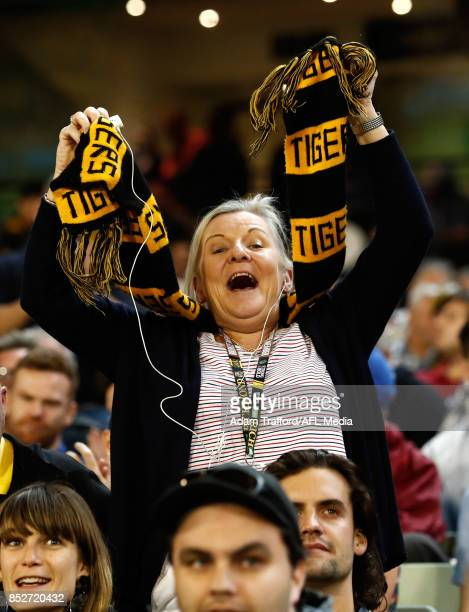 Tigers fans celebrate during the 2017 AFL Second Preliminary Final match between the Richmond Tigers and the GWS Giants at the Melbourne Cricket...