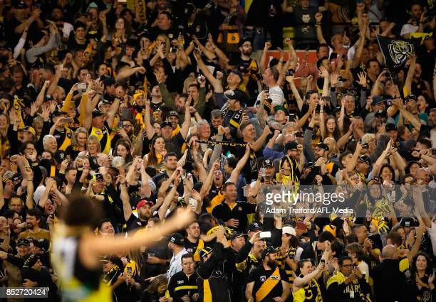 Tigers fans celebrate on the final siren during the 2017 AFL Second Preliminary Final match between the Richmond Tigers and the GWS Giants at the...