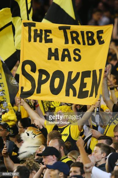Tigers fans celebrate their win during the round one AFL match between the Carlton Blues and the Richmond Tigers at Melbourne Cricket Ground on March...