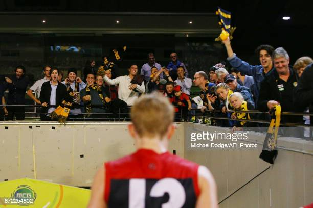 Tigers fans celebrates the win in front of Clayton Oliver of the Demons during the round five AFL match between the Richmond Tigers and the Melbourne...