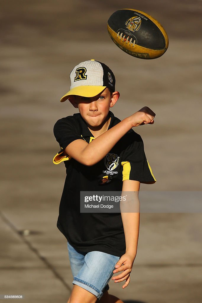 Tigers fans have kick to kick during a Richmond Tigers AFL training session at ME Bank Centre on May 27, 2016 in Melbourne, Australia.