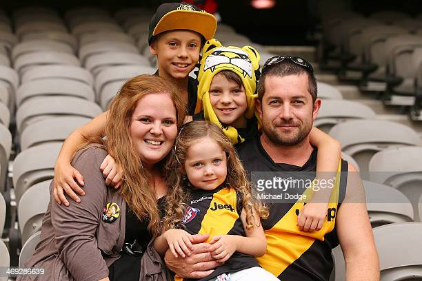 Tigers fans show their support during the round one AFL NAB Challenge Cup match between the Richmond Tigers and the Melbourne Demons at Etihad...