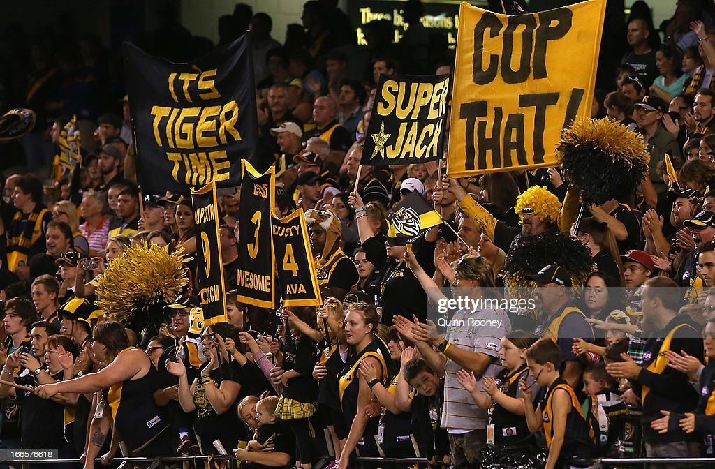 Tigers fans show their support during the round three AFL match between the Richmond Tigers and the Western Bulldogs at Etihad Stadium on April 14, 2013 in Melbourne, Australia.