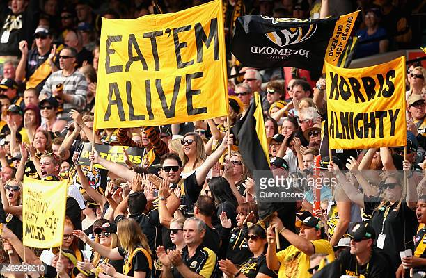 Tigers fans show their supportduring the round two AFL match between the Richmond Tigers and the Western Bulldogs at Melbourne Cricket Ground on...