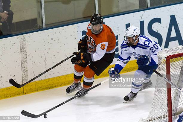 Tigers forward Liam Kerins chases after Air Force Falcons defenseman Dan Bailey for the puck during the 1st period of the game between the Air Force...
