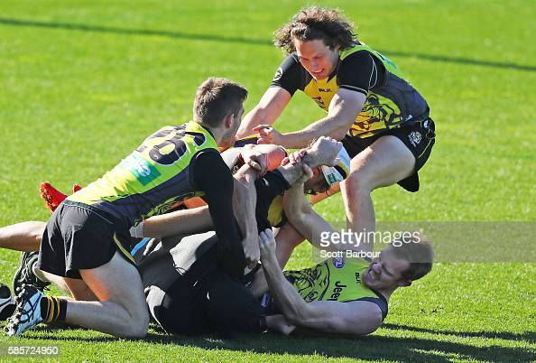 Tigers Forwards Coach Greg Mellor Anthony Miles Tyrone Vickery Sam Lloyd and Jack Riewoldt of the Tigers wrestle during a Richmond Tigers AFL...