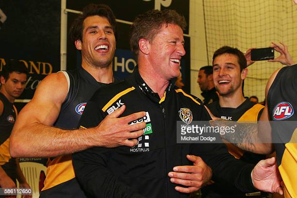 Tigers head coach Damien Hardwick celebrates the win with Alex Rance of the Tigers during the round 20 AFL match between the Richmond Tigers and the...