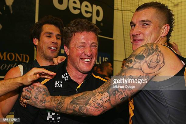 Tigers head coach Damien Hardwick celebrates the win with Dustin Martin of the Tigers during the round 20 AFL match between the Richmond Tigers and...