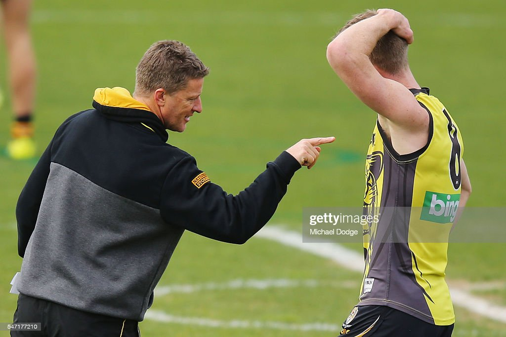 Tigers head coach Damien Hardwick gestures to Jack Riewoldt after a drill during a Richmond Tigers AFL training session at ME Bank Centre on July 14...