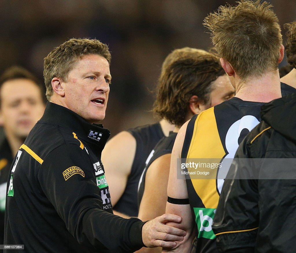 Tigers head coach Damien Hardwick grabs Jack Riewoldt of the Tigers to speak to him at quarter time during the round 20 AFL match between the...