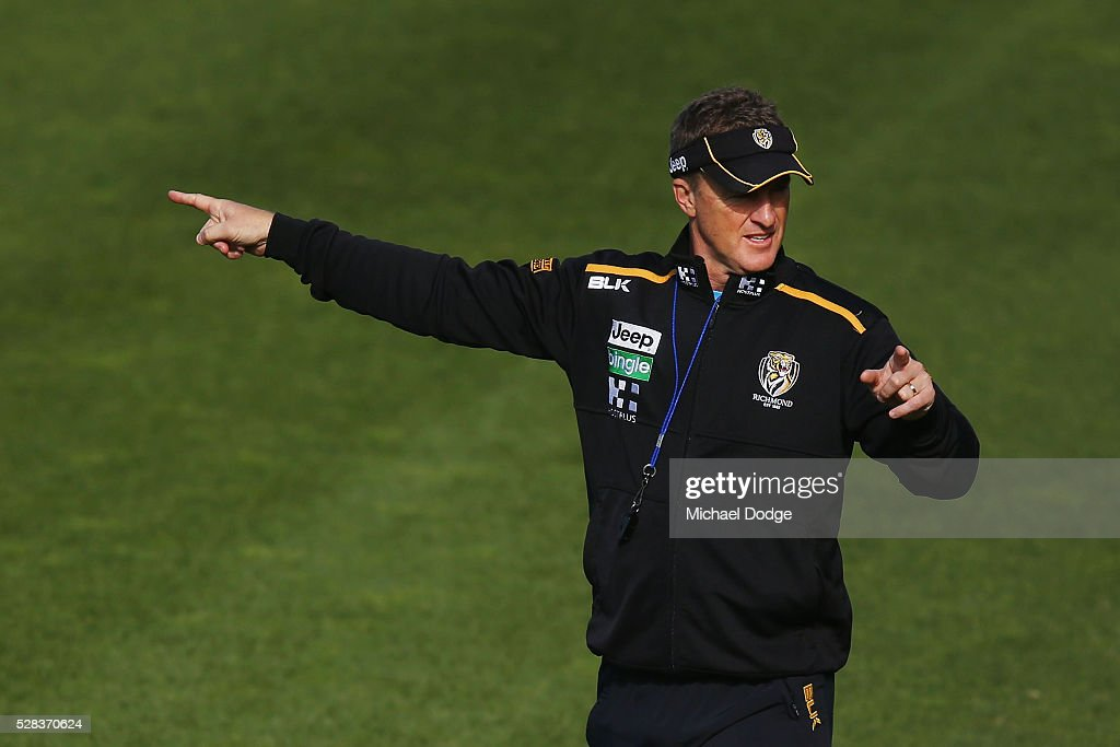 Tigers head coach Damien Hardwick points in two different directions during a Richmond Tigers AFL training session at Punt Road Oval on May 5, 2016 in Melbourne, Australia.
