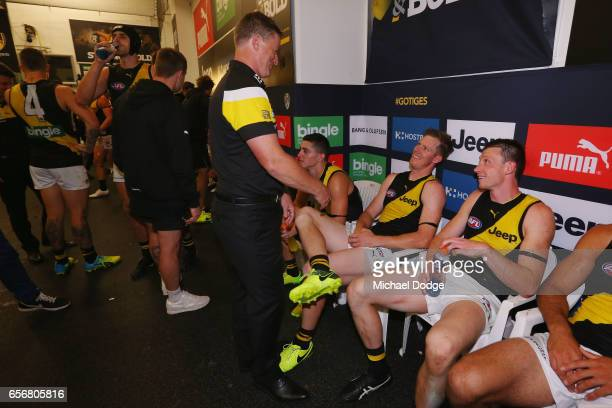 Tigers head coach Damien Hardwick speaks to Jack Riewoldt after their win during the round one AFL match between the Carlton Blues and the Richmond...