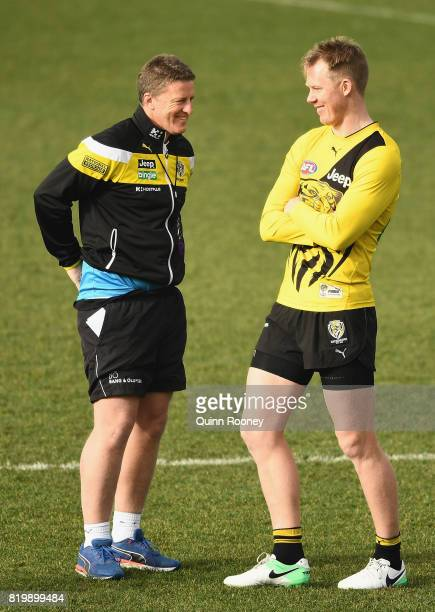 Tigers head coach Damien Hardwick speaks to Jack Riewoldt during a Richmond Tigers AFL training session at ME Bank Centre on July 21 2017 in...