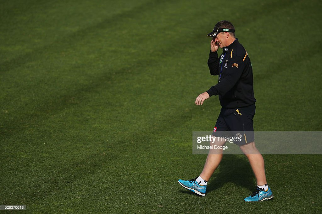 Tigers head coach Damien Hardwick walks onto the ground during a Richmond Tigers AFL training session at Punt Road Oval on May 5, 2016 in Melbourne, Australia.