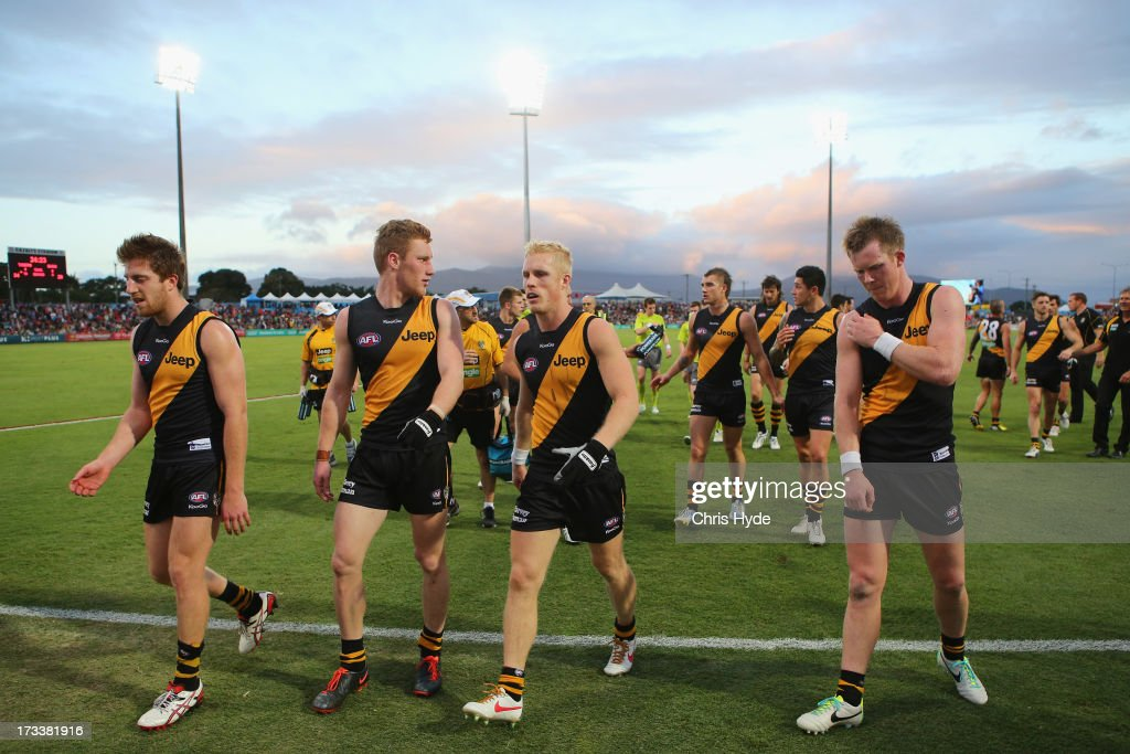Tigers leave the field at halftime during the round 16 AFL match between the Richmond Tigers and the Gold Coast Suns at Cazaly's Stadium on July 13, 2013 in Cairns, Australia.