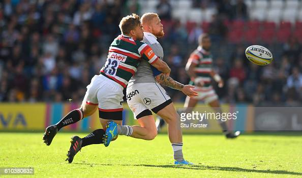 Tigers player Jack Roberts tackles Tom Homer of Bath during the Aviva Premiership match between Leicester Tigers and Bath Rugby at Welford Road on...