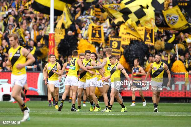 Tigers players celebrate a goal during the 2017 AFL Grand Final match between the Adelaide Crows and the Richmond Tigers at Melbourne Cricket Ground...