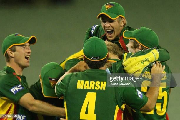 Tigers players celebrate a wicket during the Ford Ranger Cup Final match between the Victorian Bushrangers and the Tasmanian Tigers at the Melbourne...