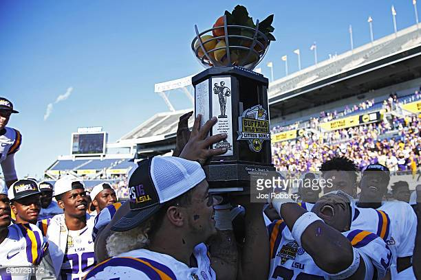 Tigers players celebrate after defeating the Louisville Cardinals 299 in the Buffalo Wild Wings Citrus Bowl at Camping World Stadium on December 31...