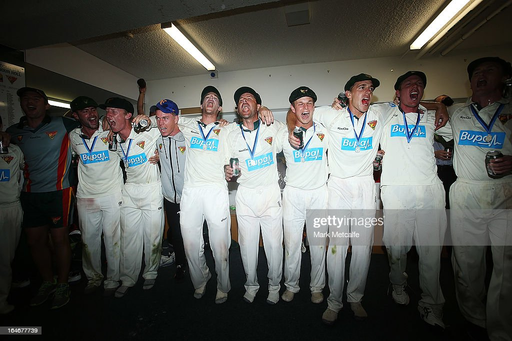 Tigers players celebrate in the changing rooms after winning the Sheffield Shield final between the Tasmania Tigers and the Queensland Bulls at Blundstone Arena on March 26, 2013 in Hobart, Australia.
