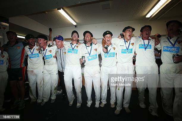 Tigers players celebrate in the changing rooms after winning the Sheffield Shield final between the Tasmania Tigers and the Queensland Bulls at...