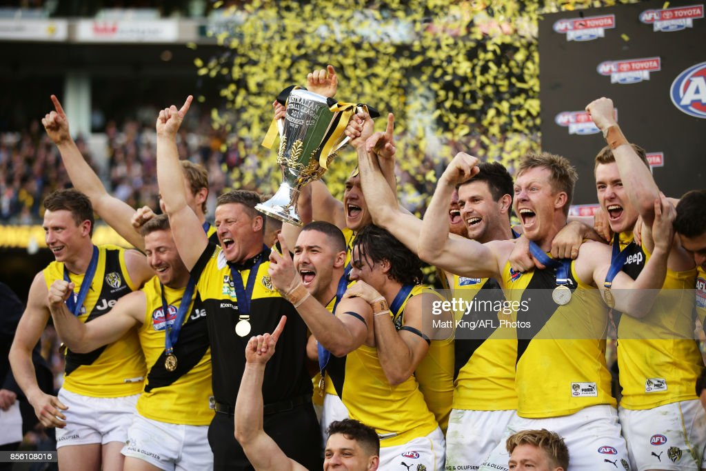Tigers players celebrate victory after the 2017 AFL Grand Final match between the Adelaide Crows and the Richmond Tigers at Melbourne Cricket Ground on September 30, 2017 in Melbourne, Australia.