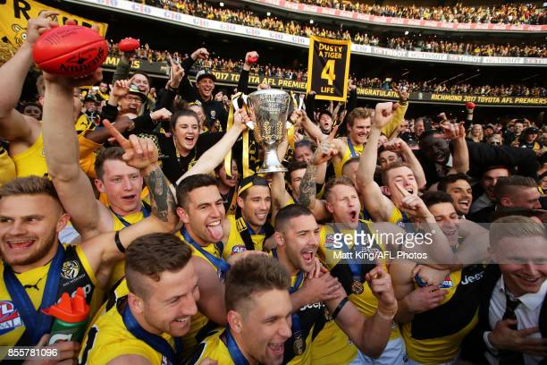 Tigers players celebrate victory with fans after the 2017 AFL Grand Final match between the Adelaide Crows and the Richmond Tigers at Melbourne...