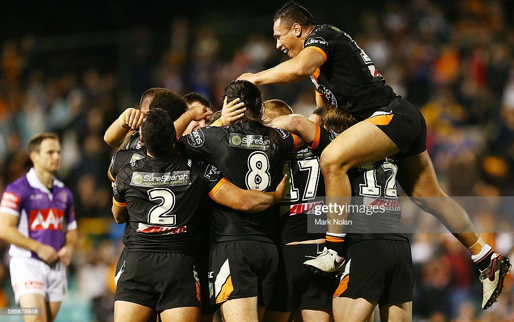 Tigers players celebrate winning the round 22 NRL match between the Wests Tigers and the North Queensland Cowboys at Leichhardt Oval on August 7, 2016 in Sydney, Australia.