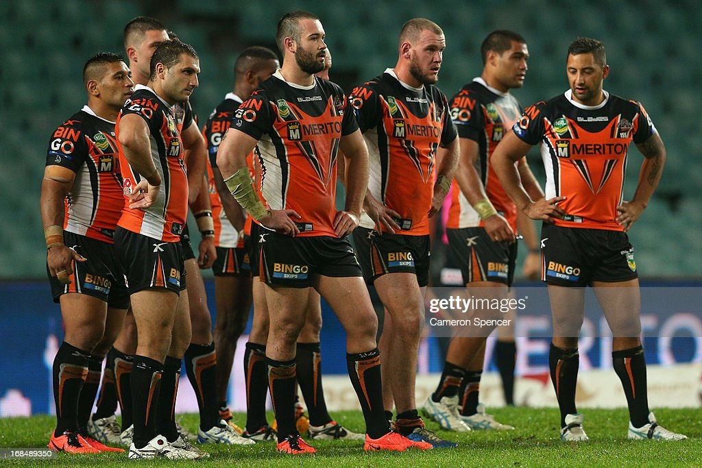 Tigers players look dejected during the round nine NRL match between the Wests Tigers and the Cronulla Sharks at Allianz Stadium on May 10, 2013 in Sydney, Australia.