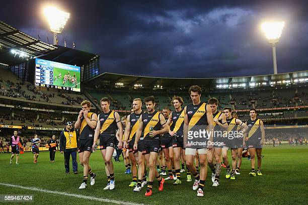 Tigers players looks dejected as they walk off after defeat during the round 21 AFL match between the Richmond Tigers and the Geelong Cats at...