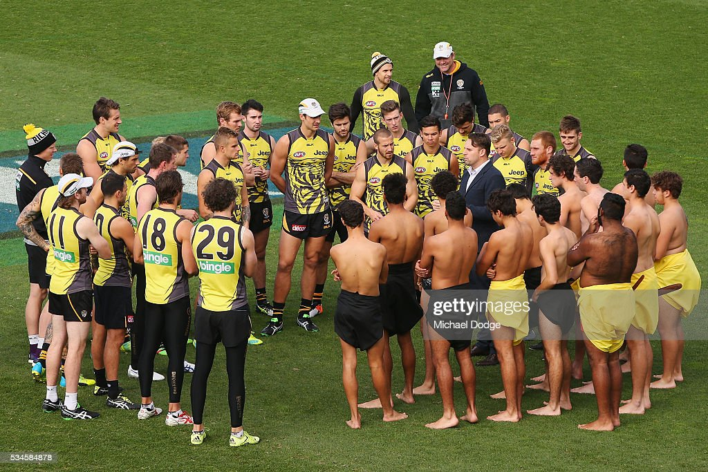 Tigers players meet 16 young Indigenous representatives before they perform a traditional war cry during a Richmond Tigers AFL training session at ME Bank Centre on May 27, 2016 in Melbourne, Australia.