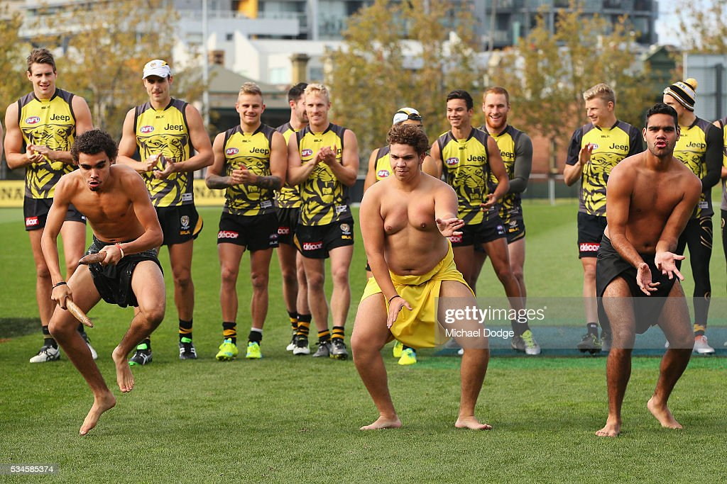 Tigers players watch 16 young Indigenous representatives perform a traditional war cry during a Richmond Tigers AFL training session at ME Bank Centre on May 27, 2016 in Melbourne, Australia. The AFL celebrates Indigenous Round this weekend.