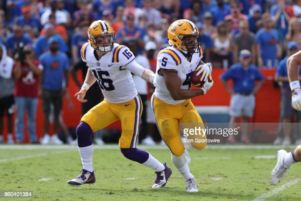 Tigers quarterback Danny Etling hands the ball off to LSU Tigers running back Derrius Guice during the college football game between the LSU Tigers...