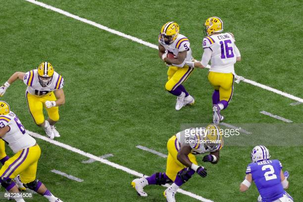 Tigers quarterback Danny Etling hands the ball off to running back Derrius Guice during the AdvoCare Texas Kickoff BYU v LSU on SEP 02 2017 at...