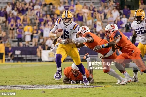Tigers quarterback Danny Etling scrambles from the pocket against Syracuse Orange during a college football game between the LSU Tigers and the...