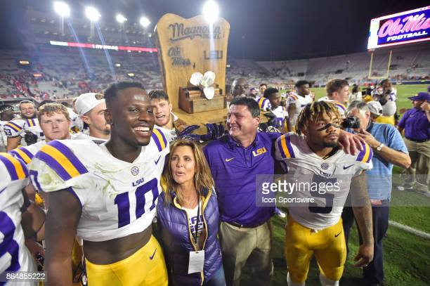 Tigers receiver Stephen Sullivan coach Ed Orgeron and running back Derrius Guice gather together for the school's alma mater after beating the...