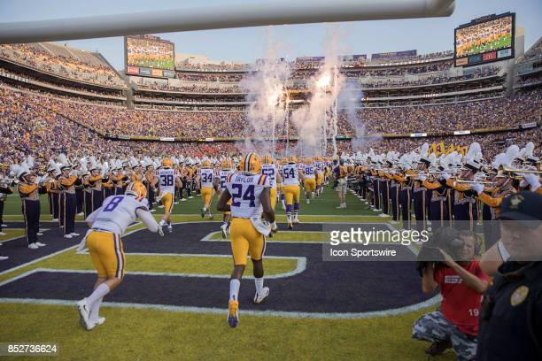 Tigers run out on the field before a college football game between the LSU Tigers and the Syracuse Orange on September 23 2017 at Tiger Stadium in...