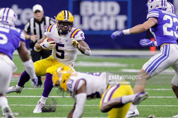 Tigers running back Derrius Guice changes direction into Brigham Young Cougars defensive back Zayne Anderson during the AdvoCare Texas Kickoff BYU v...
