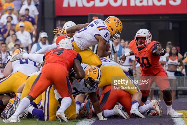Tigers running back Derrius Guice dives in for a 1 yard rushing touchdown during a college football game between the LSU Tigers and the Syracuse...