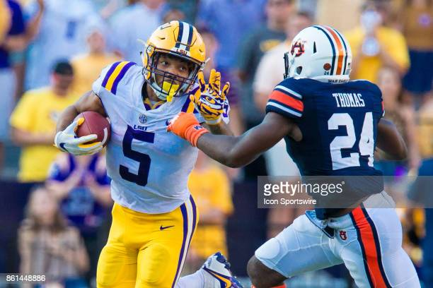 Tigers running back Derrius Guice is tackled by Auburn Tigers defensive back Daniel Thomas during the game between LSU and Auburn on October 14 2017...
