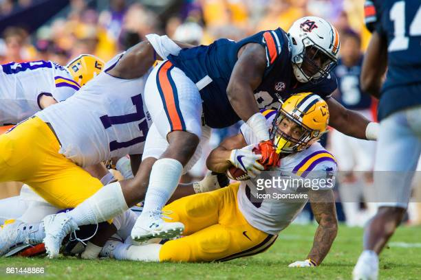 Tigers running back Derrius Guice is tackled by Auburn Tigers during the game between LSU and Auburn on October 14 2017 at Tiger Stadium in Baton...