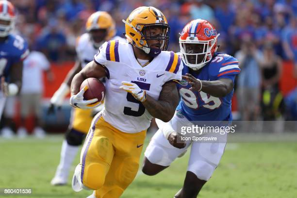 Tigers running back Derrius Guice runs the ball past Florida Gators defensive lineman Jachai Polite during the college football game between the LSU...
